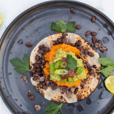 Smoky Sweet Potato Tostadas with black beans, guacamole and tomatilla salsa