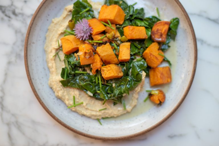 coconut roasted sweet potatoes and collard greens hummus bowl
